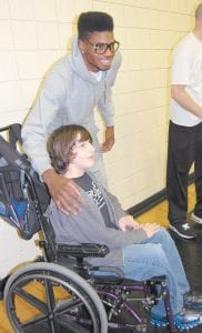 """University of Kentucky basketball star Nerlens Noel posed for a photo April 19 with Richard Johnson, a 5thgrader at West Whitesburg Elementary School. Noel, who is expected to be the No. 1 pick when the NBA draft is held June 27 in New York City, visited the elementary school and Whitesburg Middle School while in town for an appearance at Mountain Comprehensive Health Corporation's Whitesburg Medical Clinic. Noel told the students that """"education is important,"""" and said they need to """"work hard and stay focused to reach goals in life."""""""