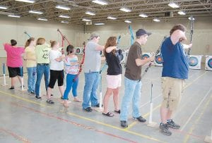 — Members of the Letcher County Central High School archery team honed their skills for this week's national archery competition in Louisville. See story, Page 2. (Eagle photo)