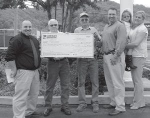 — Heather Gearheart, Chotty Thompson and Heath Wiley met with Shriners Hillbilly representatives to donate a check for money raised during the 37th annual Hillbilly Days festivities in Pikeville. Gearheart Communications, Inter Mountain Cable and Foxy 94.3 FM raised $4,150 for the Shriners Children's Hospital in Lexington.