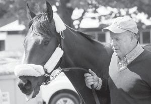 Assistant trainer Buzz Tenney led Kentucky Derby winner Orb earlier this week. (AP Photo)