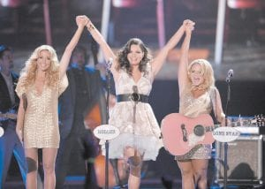 Eastern Kentucky native Angaleena Presley (center) stars in the Pistol Annies with Ashley Monroe (left) and country music star Miranda Lambert (right).