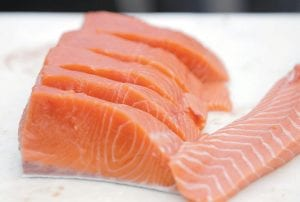 Filets of Copper River Salmon from Alaska are shown. Eating fish is good for your heart, but taking fish oil capsules does not help people at high risk of heart problems who are already taking medicines to prevent them, a large study in Italy has found. (AP Photo)