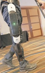 Michael Gore, paralyzed from a spinal injury, walks with the use of the Indego wearable robot. (AP)