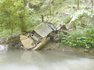 Tarence Ray, an AmeriCorps VISTA volunteer with Headwaters Inc., took this photograph on May 11 of a car embedded on the bankof the North Fork of the Kentucky River.