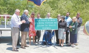 ROAD NAMED IN HONOR OF SHERIFF — Among those attending a ceremony honoring Letcher County Sheriff Danny R. Webb were State Sen. Johnny Ray Turner, Darrell Holbrook, Webb, State Rep. Leslie Combs, Arius Holbrook, Whitesburg Mayor James W. Craft, Webb's sister Lisa Webb Stansberry, Webb's wife Sharon Webb, one of the Webbs' sons Jody Webb and Letcher County Judge/Executive Jim Ward Letcher County Court Clerk Winston Meade and Letcher Circuit Judge Sam Wright also attended but are not pictured.