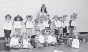 Derby Day for the preschool classes at West Whitesburg Elementary School was May 2. Each student raced with a stick pony and wore Derby hats they had made. Pictured is the morning preschool class of Melissa Addington (front row, left to right) Taylor Wright, Sydney Vanover, Evan Fleming, Shade Caudill, Mia Sexton, Molly Hall, Kevin Hall, (back row) Peyton Hammonds, Colton Stidham, Isaiah Adams, Macey Warf, Ava Thomas, Logan Thomas, Raegan Turner, Caleb Sexton and Dylan Polly. Melissa Addington stands in back of the class.