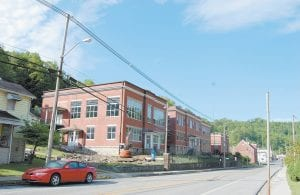The old Jenkins High School will soon become Jenkins School containing apartments for senior citizens, a senior citizens center and a television studio for the government channel. Completion date is projected to be November.