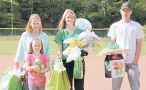 Jenkins High School paid tribute to fast pitch softball players who are graduating seniors. Above, Brittany Mullins was escorted onto the field by parents Wayne Mullins and Valentina Everly and sister Kaylee Mullins.