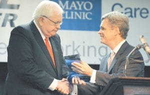 Mayo Clinic Southeast Medical Director Stephen Lange, M.D., presented a special award to Pikeville Medical Center President and Chief Executive Officer Walter E. May during a press conference in Pikeville last week.