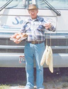 GARDENER — O'Dell Sloane of Hollansburg, Ohio, displays white cucumbers and plum grannies, a type of melon, grown in his garden.