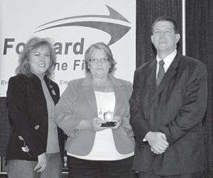 Jim Tackett, right, executive director of Forward in the Fifth, and Dr. Dessie Bowling, left, board chairman, present Debbie Joseph Smith, with the 2013 Appalachian Leaders in Education Award in the K-12 support staff category.