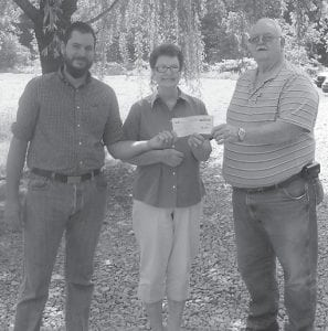 """Eolia Christian Community Outreach received a $20,000 grant from EQT. From left to right are Steve Erickson, SWAP site coordinator and ECCO grant proposal writer; ECCO President Brenda Gross; and ECCO Vice-President Kess Halcomb. ECCO officials said, """"We greatly appreciate EQT for considering our community in their giving."""""""