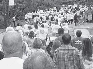 About 400 people participated in a prayer march and gathering of Action Against Substance Abuse on June 2. The walk began at Mountain Heritage Village in Whitesburg and ended at the Whitesburg Middle School football field.