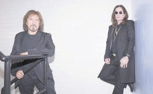Black Sabbath bassist Geezer Butler (left) and Ozzy Osbourne (right) posed for photos recently. (AP)