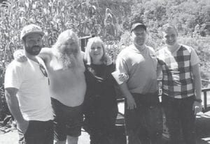 From left to right are Andrew Wobbe, Mae Palumbo's grandson; Larry Hatton, Oma Hatton's son; Jane Cox, Mae Palumbo's daughter; Chris Hatton, Larry Hatton's son; and Beau Hatton, Oma Hatton's grandson.