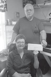 Brenda Gross and Kess Halcomb recently accepted a donation of $1,000 for Eolia Christian Community Outreach from Alpha Natural Resources.