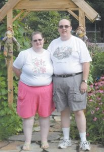 At left, Paul David Sturgill and his wife, Adrienne, are seen before they joined Weight Watchers. The results of their hard work and determination to get healthy can be seen in the photo above.