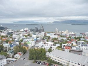 "Pictured above is Reykjavik, Iceland as photographed by Dillion Asher. Pictured at right is the commemorative statue of Leif Eriksson and the steeple of Hallgrimmskirkja Church, from where Asher and his girlfriend, Lisa Brignoni viewed ""mountains of volcanic origin, wisps of steam from distant geysers, broad and expansive plains formed by lava flows and numerous fjords and inlets to the ocean."""