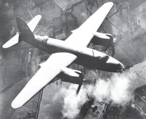 "Letcher County native Ray Harding Hogg piloted a B-26 Marauder bomber during World War II in Europe. In this photo, the Marauder is seen dropping 300-pound bombs to blast hangar buildings and dispersal areas of the Airdrome at Triqueville, France on Nov. 26, 1943 where the famed ""Yellow-Nosed"" German fighter squadron was based. Hogg was transferred to France less than 14 months after this photo was taken. (AP Photo)"