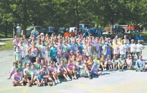 "Contestants posed for a photo after the inaugural 5K event ""Color Me Crazy Red, White and Blue Run, Walk, Crawl"" in Whitesburg on Saturday. The race was sponsored by the Letcher County Mountain Heritage Festival Committee. (Photo by Connie Hall Fields)"