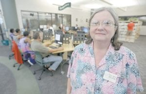 Branch librarian Nancy Agafitei poses near a computer section of the Barbara Bush Branch Library in Spring, Texas. The nation's librarians will be recruited to help people get signed up for insurance under the health care overhaul. (AP Photo)