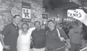 Matt Jones (pictured at left above and at right) was in Whitesburg on June 28 for a live two-hour airing of his Kentucky Sports Radio call-in show. The program, which airs weekday mornings from 10 until noon on WTCW-AM, aired from Pine Mountain Grill to a crowd of more than 100 University of Kentucky sports fans. In the photo above, Jones poses with a group that included WTCW sportscaster Larry Hatton and station manager Kevin Day. At right, Jones has his photo taken with UK student Savannah Baker of Whitesburg.