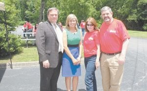 """Kentucky Senate President Robert Stivers (left) and his new wife, Letcher County native Regina Combs Stivers, were guests at a recent employee appreciation dinner at Mountain Comprehensive Health Corporation in Whitesburg. Greeting the Stiverses were MCHC CEO L.M. """"Mike"""" Caudill (right) and his wife Joy."""