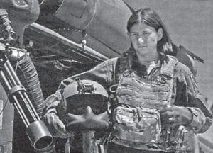 Airman First Class Natasha Libby, a 66th Rescue Squadron aerial gunner, stands next to an HH-60 Pave Hawk at Nellis Air Force Base, Nev. (U.S. Air Force photo/Senior Airman Daniel Hughes)