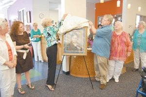 During the grand opening of the Fleming-Neon Public Library on July 21, Sally Webb Caudill, of Whitesburg, Gillie Webb, of Hazard, and Alberta G. Kummer, of Louisville, unveiled a portrait of the late Lillian Fugate Webb, the first female mayor of Fleming-Neon and a literature teacher at Fleming-Neon High School. Caudill is a sister of Webb and Kummer and Gillie Webb are two of Lillian Webb's children. The previous library in Fleming-Neon was named after Lillian Webb in 1971. The community room of the new library is named in memory of Lillian Webb.