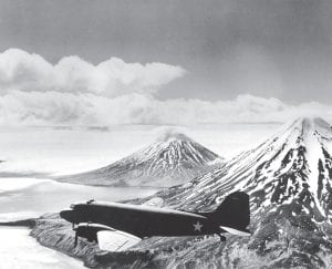A Naval Air Transport Service plane is seen en route to the Aleutian front over Alaskan Territory during World War II. (AP Photo)