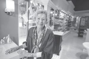 June Springer poses for a photograph where she works at Caffi Contracting Services in Alexandria, Va. Springer, who just turned 90, works as a receptionist. People who delay retirement have less risk of developing Alzheimer's disease or other types of dementia, a study of half a million people in France found. (AP Photo)