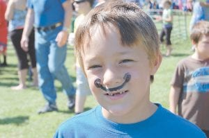 Above, Joshua Holbrook, 6, sported a mustache at the Back to School Bash. Face painting was one of several free activities available. Joshua's father, Joe Holbrook of Mayking, took him to the event. Joshua will be a first-grader at Martha Jane Potter School.
