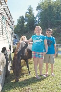 Siblings Miranda Milam, 10, and Kobe Milam, 12, of Jenkins, posed for a photo with ponies. They are the children of Bobby and Jerrica Milam.