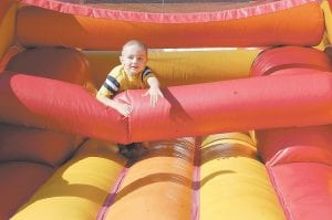 Above, Gabriel Gilliam, 5, climbed through an inflatable shaped like a large red dragon. Gabriel, a son of Michael and Kristy Gilliam of Mayking, will attend kindergarten at West Whitesburg Elementary School in August.