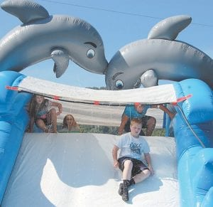 Matt Craft, 10, of Mayking, cooled off on a large inflatable slide. Matt, who will soon begin his fifthgrade year at West Whitesburg Elementary, is a son of Amy and Richard Craft.