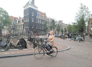 """Bicycles are a very important means of transportation in Amsterdam."" Dillion Asher wrote before leaving London for Mongolia. ""The entire city, even most of country, has evolved to incorporate them into its transportation system much as modern America has done with the automobile. The more of the city I observed the more I noticed hundreds, if not thousands of bicycles lining the sidewalks and crowded together in parking areas."""