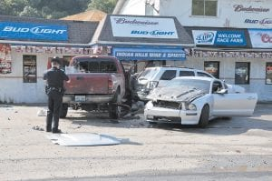 FATAL WRECK — An officer photographed the aftermath of a wreck that killed Mayking resident Kelly Caudill while Caudill was standing beside the truck at left. (Photo by Chris Anderson/Appalachian News-Express)