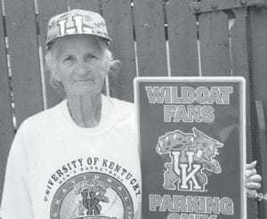 "Loretta Lucas Blair displays her ""Wildcat fans parking only"" sign to Indiana residents. She asks her big brother Neal, ""What do you think?"""