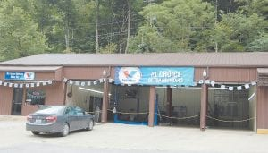 Isom businessman Mike Breeding and his son, Shane, have opened Pro Lube on Garner Mountain near Isom. At left is a photo of the modern new waiting area.