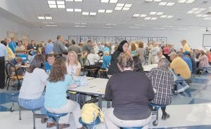 """More than 260 people had signed in by 6 p.m. Tuesday to express their interest in locating a federal prison in Letcher County. The """"scoping meeting"""" was held in advance of an environmental impact statement that will determine whether a prison can be suitably located here. (Photo by Sally Barto)"""