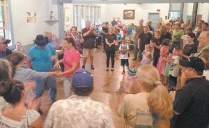 The largest crowd of people in many years attended the Carcassonne Square Dance August 9 for a fundraiser to help ensure that the dance remains a vital part of the Carcassonne Community Center. (Photo courtesy Brett Ratliff )