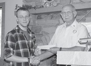 Rotary President Larry Whitaker presented the Whitesburg Rotary Club Scholarship to Billy Gene Mullins.