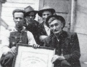 The late Dewey Brown, Henry Pennington, Russ Howard and Willie King, Marlowe coal miners, are pictured at a United Mine Workers of America union meeting which took place some time ago.