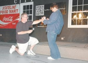 Below, Rick Hall of the Letcher County government channel took to the festival stage to ask Shelia Swisher of Whitesburg to marry him. She accepted.