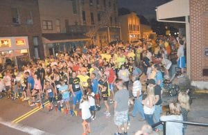 Observers watched as participants in ther 5K night race lined up on Main Street in Whitesburg, between Summit City and StreetSide Grill & Bar. (Photo by Sally Barto)