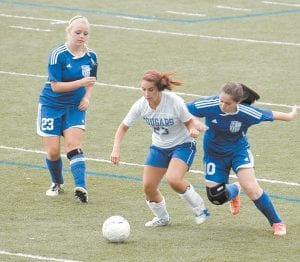 In the photo above, senior forward Brooke Kincer (23) dribbled the ball between two Paintsville defenders in a 7-0 win at Ermine on August 22.