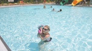 At right, Chrystal Bentley and daughter Bella enjoyed the pool in Saturday's 90 degree heat.