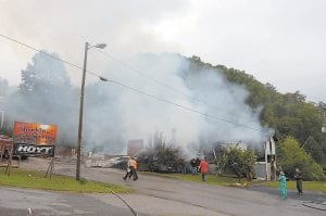 Hatfield's Hunting and Fishing and an apartment located at the back of the building were destroyed by a fire believed to have been caused by faulty wiring Tuesday morning at Van. (Eagle photo)