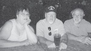 Sue Banks and her brothers, Kyle and Glenn Flanary, are pictured eating at a seafood bar and grill in Sarasota, Fla.
