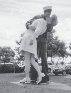 This 25- to 30-foot statue of a sailor and a nurse is found in Florida. A picture of them kissing was taken at the announcement of the end of World War II and was seen all over the world.